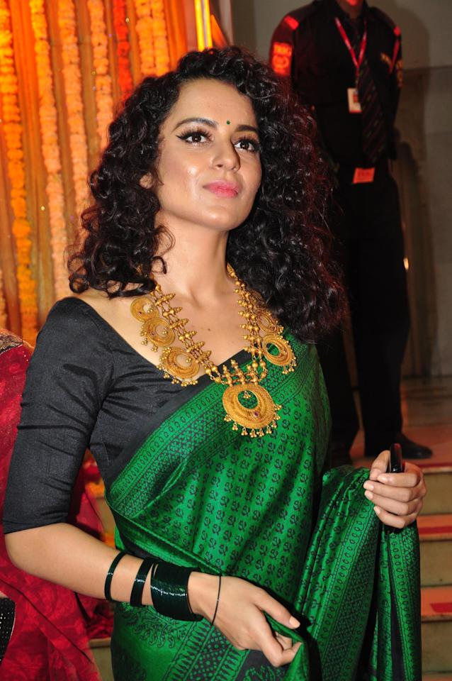 All that glitters… is most definitely gold around Kangana Ranaut's neck.