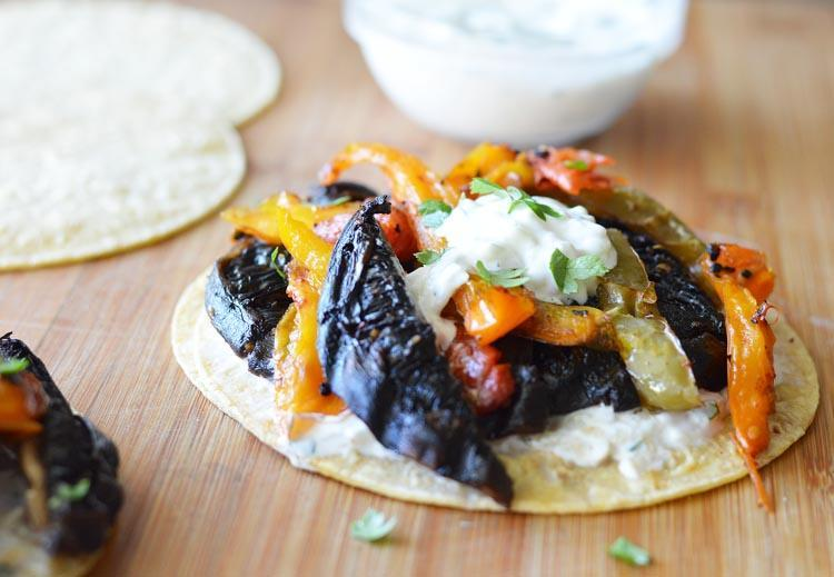 """<p>Cool cucumber ranch dressing adds the perfect contrast to grilled portobellos and peppers.</p> <p>Get the recipe <a href=""""https://theveglife.com/portobello-tacos-cucumber-ranch-dressing-vegan/"""" rel=""""nofollow noopener"""" target=""""_blank"""" data-ylk=""""slk:here"""" class=""""link rapid-noclick-resp"""">here</a>.</p>"""