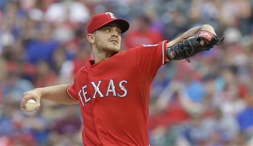 Texas Rangers starting pitcher Justin Grimm (51) throws during the first inning of the baseball game against the Detroit Tigers Saturday, May 18, 2013, in Arlington, Texas. (AP Photo/LM Otero)