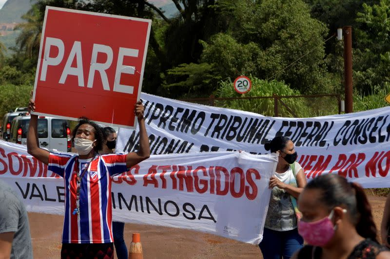 FILE PHOTO: People affected by the disaster of the tailings dam owned by Brazilian mining company Vale SA, protest in front of the company, two years after it collapsed in Brumadinho