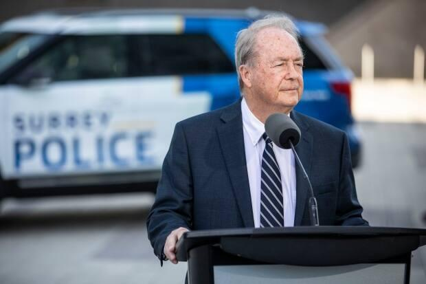 Surrey mayor Doug McCallum has said in the past that the actual referendum was the last municipal election when he promised to bring in a Surrey police force. He is pictured near a Surrey Police vehicle during his state of the city address on May 7, 2019.