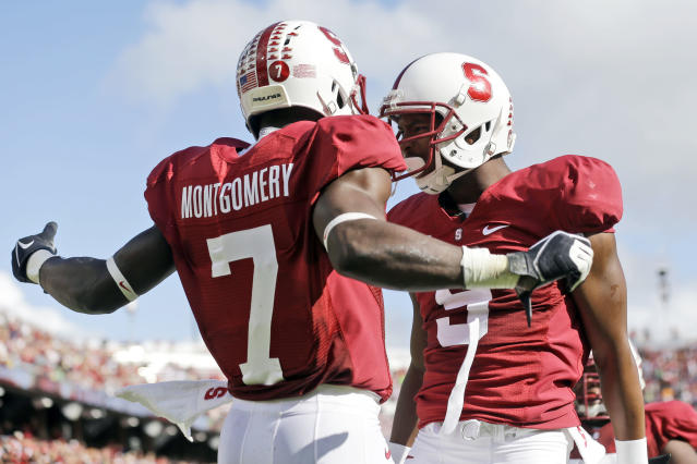 Stanford wide receiver Ty Montgomery (7) celebrates his touchdown reception with teammate Kodi Whitfield against Arizona State during the first half of an NCAA college football game on Saturday, Sept. 21, 2013, in Stanford, Calif. (AP Photo/Marcio Jose Sanchez)