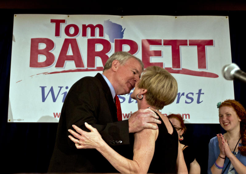 Wisconsin Democratic gubernatorial candidate, Milwaukee Mayor Tom Barrett, kisses his wife Kris at his primary election victory party Tuesday, May 8, 2012, in Milwaukee. Democrats overwhelmingly picked Barrett to challenge Republican Wisconsin Gov. Scott Walker in a June recall election. (AP Photo/Morry Gash)