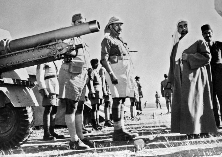 Abdullah and his British army commander General Sir John Bagot Glubb review allied Iraqi troops ahead of the Arab-Israeli war of 1948, which triggered the first in a series of exoduses of refugees that were to transform his country