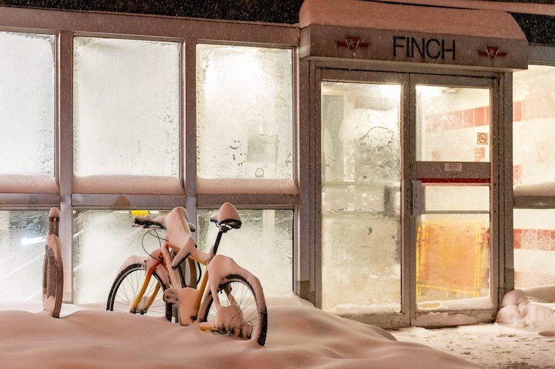 <p>A lonely bicycle is seen covered in snow outside a TTC station entrance in the North York area of Toronto on Jan. 28, 2019. Photo from The Canadian Press. </p>