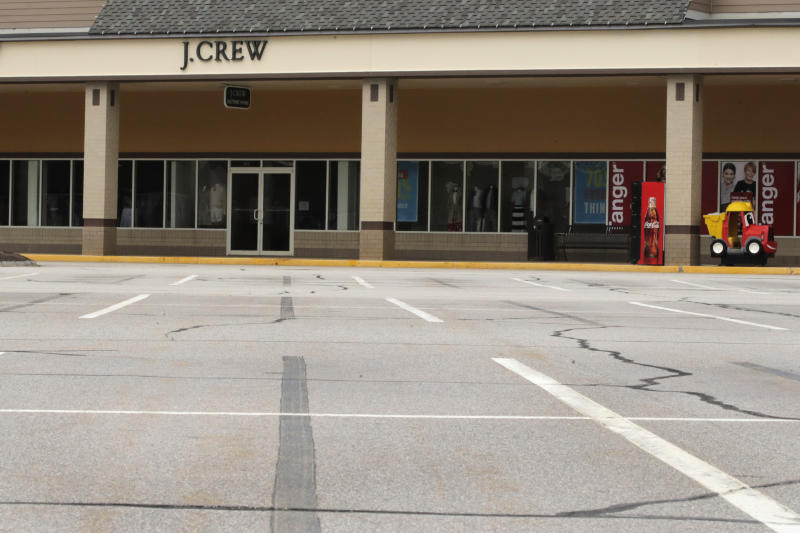 An empty parking is visible outside the J.Crew store, closed due to the COVID-19 virus outbreak, in Tilton, New Hampshire, Monday, May 4, 2020. The owner of J.Crew is filing for bankruptcy protection, the first major retailer to do so since the pandemic forced the closing of most stores in the United States. More retail bankruptcies are expected in coming weeks with the doors of thousands of stores still locked. (AP Photo/Charles Krupa)