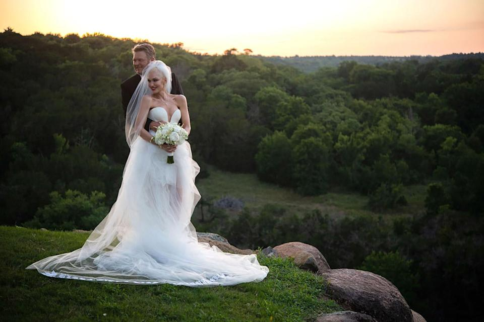 """<p>The singer had <a href=""""https://people.com/style/vera-wang-designed-gwen-stefanis-wedding-dress/"""" rel=""""nofollow noopener"""" target=""""_blank"""" data-ylk=""""slk:two custom Vera Wang dresses for her July 3 wedding to Blake Shelton"""" class=""""link rapid-noclick-resp"""">two custom Vera Wang dresses for her July 3 wedding to Blake Shelton</a>: a traditional gown with a sweetheart neckline and chapel-length veil embroidered with the names of her kids ... </p>"""