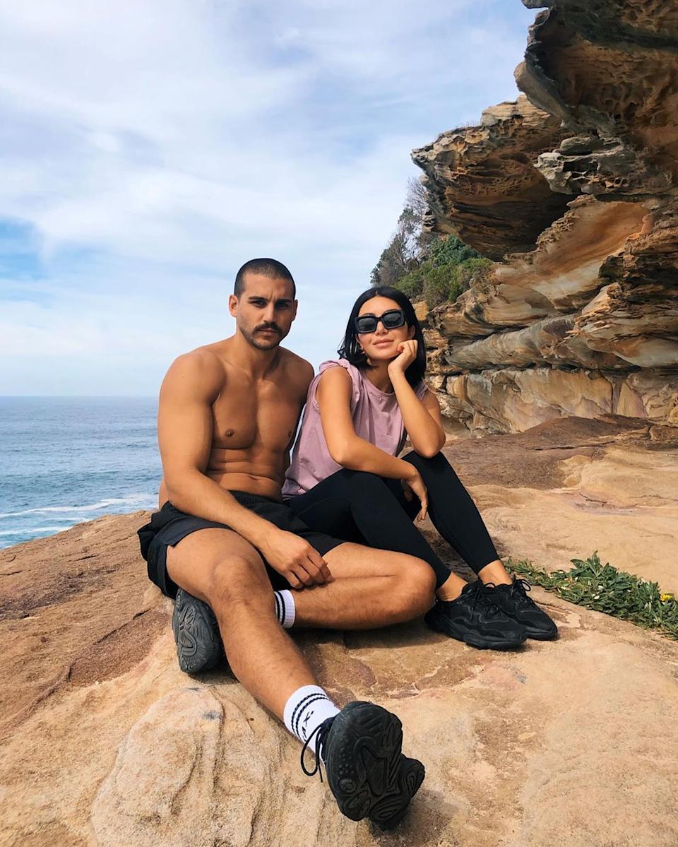Martha and Michael  from MAFS sitting on a clifftop