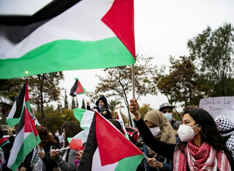Protesters in Chile began their demonstration outside Club Palestino with dancing, waving of Palestinian flags and signs
