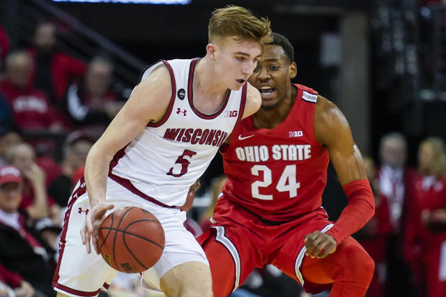 Wisconsin's Tyler Wahl (5) drives against Ohio State's Andre Wesson (24) during the first half of an NCAA college basketball game Sunday, Feb. 9, 2020, in Madison, Wis. (AP Photo/Andy Manis)