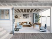 <p>Accordion glass doors connect this living room designed by Tamsin Johnson to the surrounding deck area, which is totally bare. This provides the benefits of open-air living you'd get from an outdoor space but also keeps pathways clear. </p>