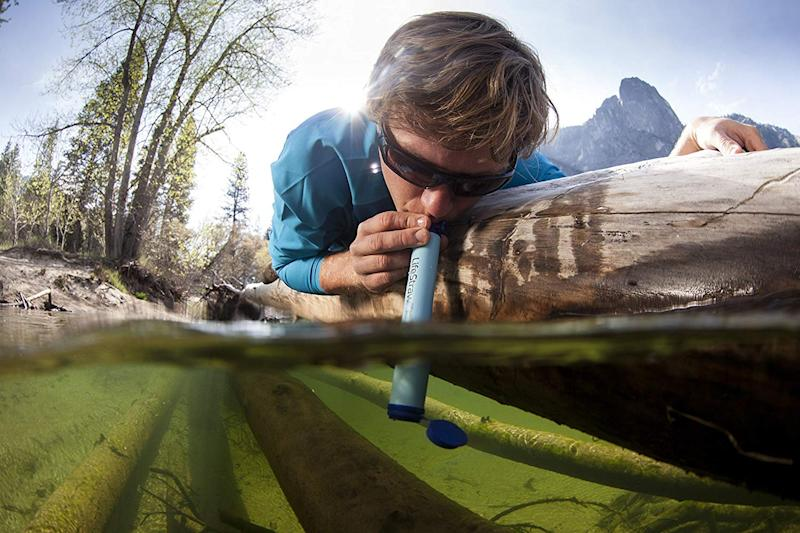 The LifeStraw lets you sip straight from a stream or other body of water. (Photo: Amazon)