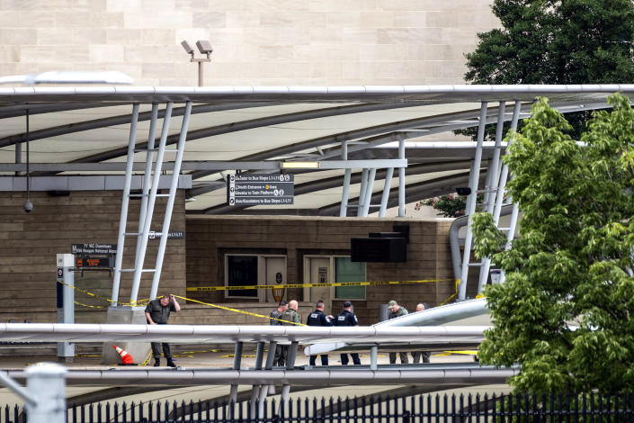 Image: A police officer passes underneath barrier tape outside the Pentagon Metro area on Aug. 3, 2021, at the Pentagon in Washington. (Kevin Wolf / AP)