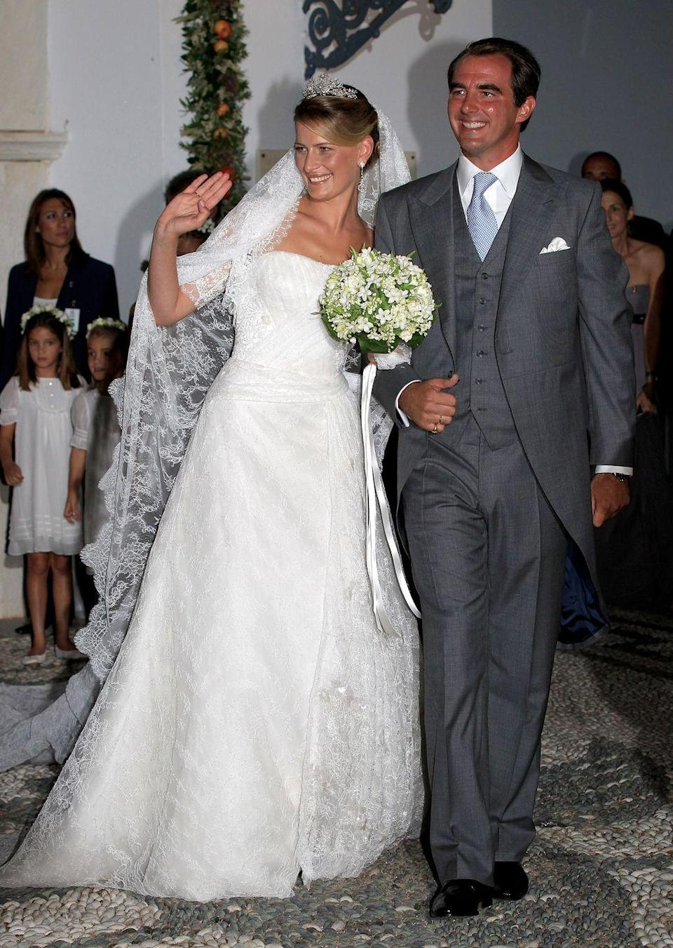 <p>Former event planner, Tatiana Blatnik, married Prince Nikolaos of Greece and Denmark in a Chantilly lace and tulle gown by designer Ángel Sánchez. </p>