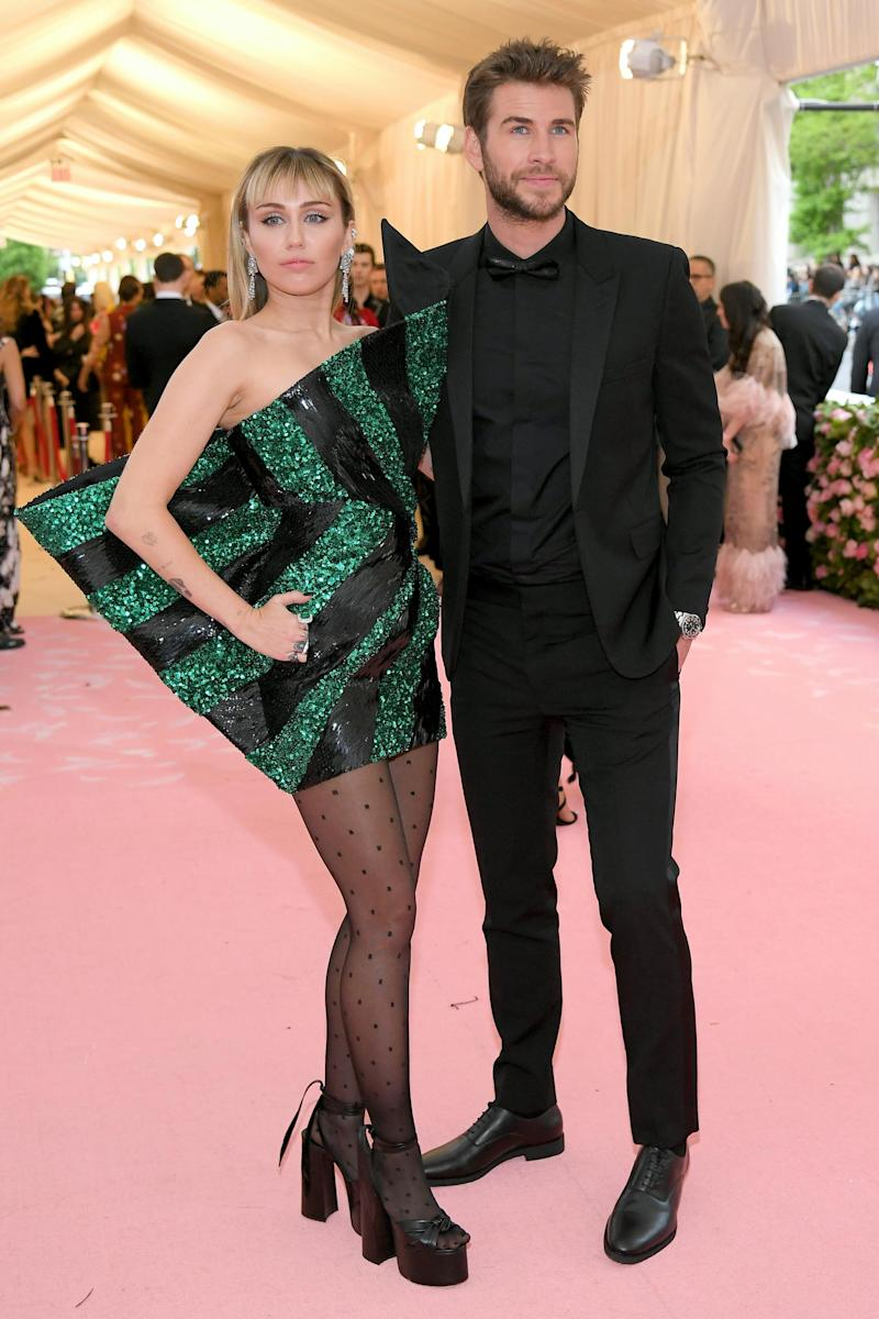 Split: Miley Cyrus with Liam Hemsworth at the Met Gala earlier this year (Getty Images)