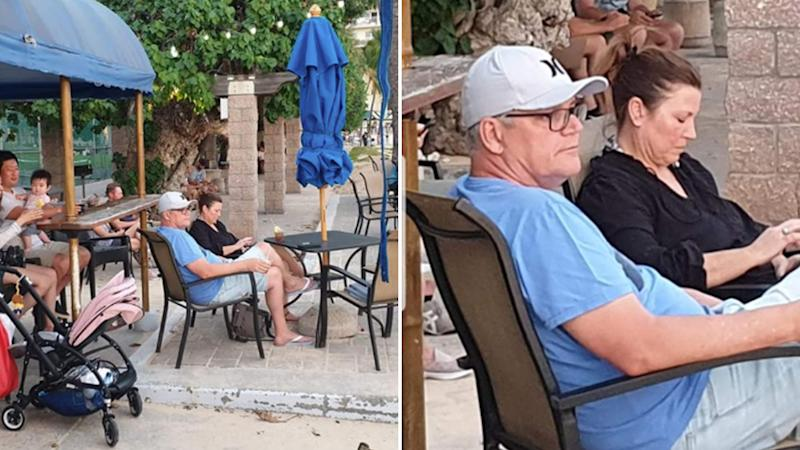 Scott Morrison sits on a beach with his wife in Hawaii. The image started to circulate online after he would 'rush back' to Australia amid bushfires.