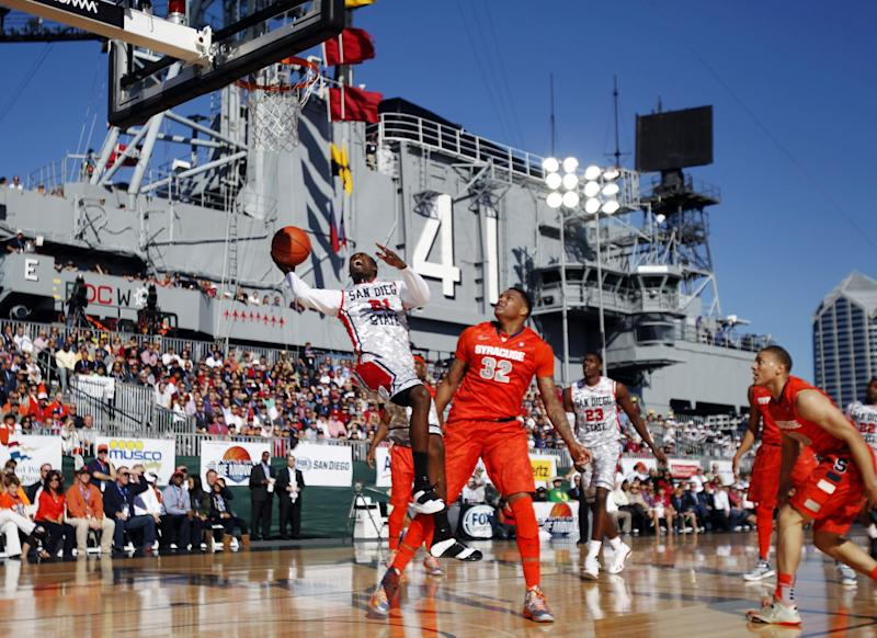 San Diego State guard Jamaal Franklin, left, shoots as Syracuse forward DaJuan Coleman (32) defends during the first half of an NCAA college basketball game on the deck of the USS Midway, Sunday, Nov. 11, 2012, in San Diego. (AP Photo/Lenny Ignelzi )