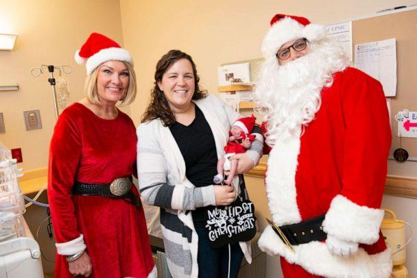 PHOTO: Mr. and Mrs. Claus pictured with Dana Kirschner and her baby, Emily, at UPMC Magee-Womens Hospital. (UPMC)