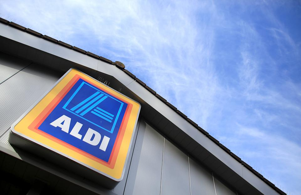 The exterior of an Aldi store, which has eliminated plastic produce bags at its banana stand.