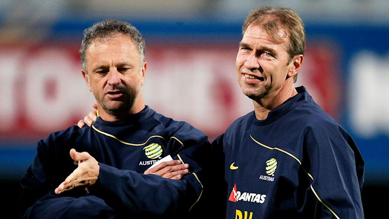 Pictured here is current Socceroos coach Graham Arnold with former coach Pim Verbeek.