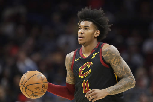 Cleveland Cavaliers' Kevin Porter Jr. drives against the Philadelphia 76ers in the first half of an NBA basketball game, Wednesday, Feb. 26, 2020, in Cleveland. (AP Photo/Tony Dejak)