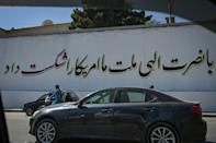 Many of Kabul's blast walls are now covered with Taliban propaganda slogans (AFP/Aamir QURESHI)