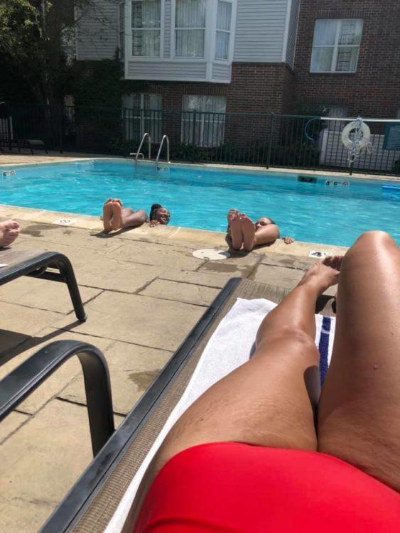 Woman legs lounging by the pool