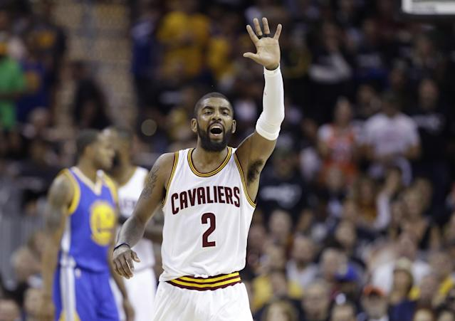 <p>Cleveland Cavaliers guard Kyrie Irving reacts in the first half against the Cleveland Cavaliers in Game 4 of basketball's NBA Finals in Cleveland, Friday, June 9, 2017. (AP Photo/Tony Dejak) </p>