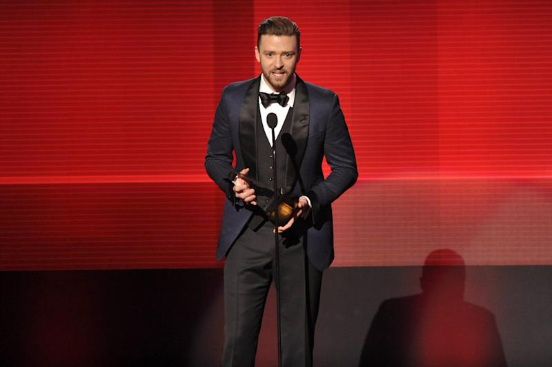 Justin Timberlake accepts the award for favorite male artist - soul/R&B at the American Music Awards at the Nokia Theatre L.A. Live on Sunday, Nov. 24, 2013, in Los Angeles. (Photo by John Shearer/Invision/AP)