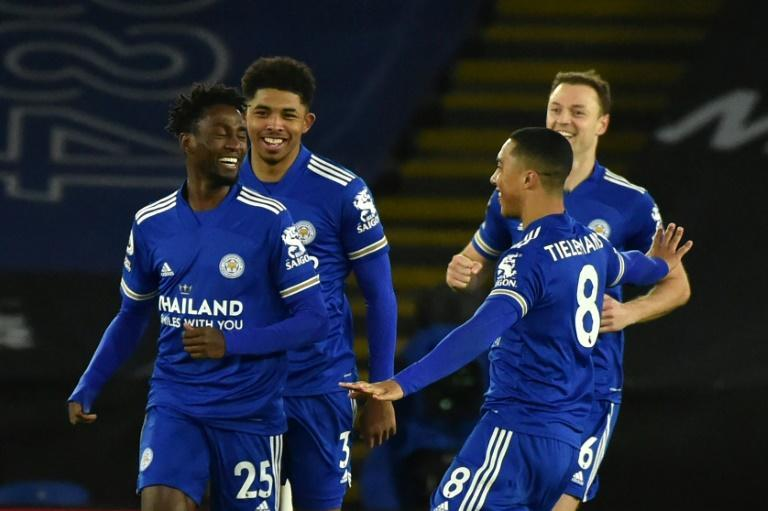 Cunning Foxes: Wilfried Ndidi (left) scored the opening goal as Leicester moved top of the Premier League