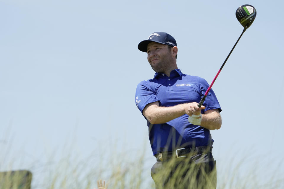 Branden Grace, of South Africa, watches his tee shot on the 16 tee during the second round of the PGA Championship golf tournament on the Ocean Course Friday, May 21, 2021, in Kiawah Island, S.C. (AP Photo/David J. Phillip)