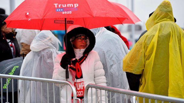 PHOTO: People line up in the rain and icy weather outside the SNHU arena hours ahead of President Donald Trump's rally in Manchester, N.H., Feb. 10, 2020. (Joseph Prezioso/AFP via Getty Images)