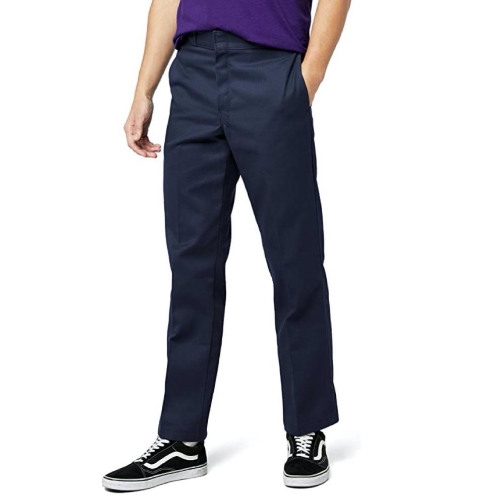 white man in blue pants and vans