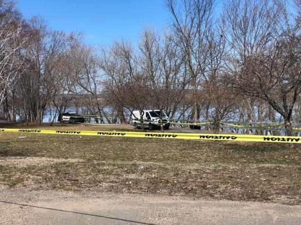 Fredericton police are searching near the St. John River after responding to a report of a man who entered the water and never came out. (Gary Moore/CBC - image credit)