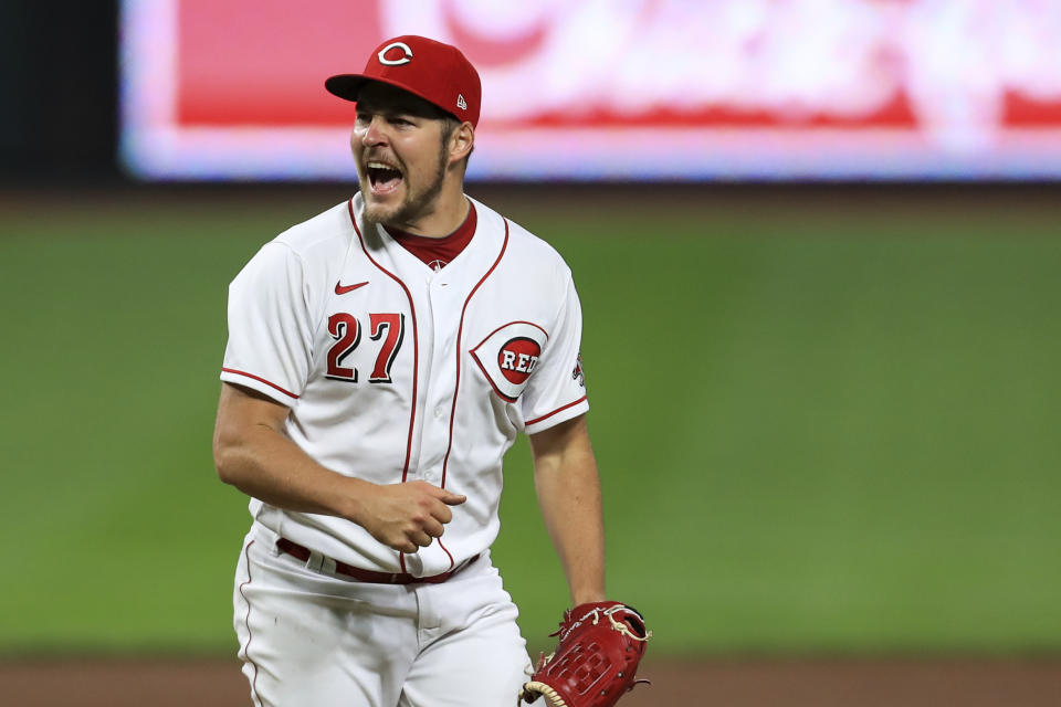 Cincinnati Reds' Trevor Bauer reacts after recording a strikeout against Milwaukee Brewers' Christian Yelich during a baseball game in Cincinnati, Wednesday, Sept. 23, 2020. The Reds won 6-1. (AP Photo/Aaron Doster)