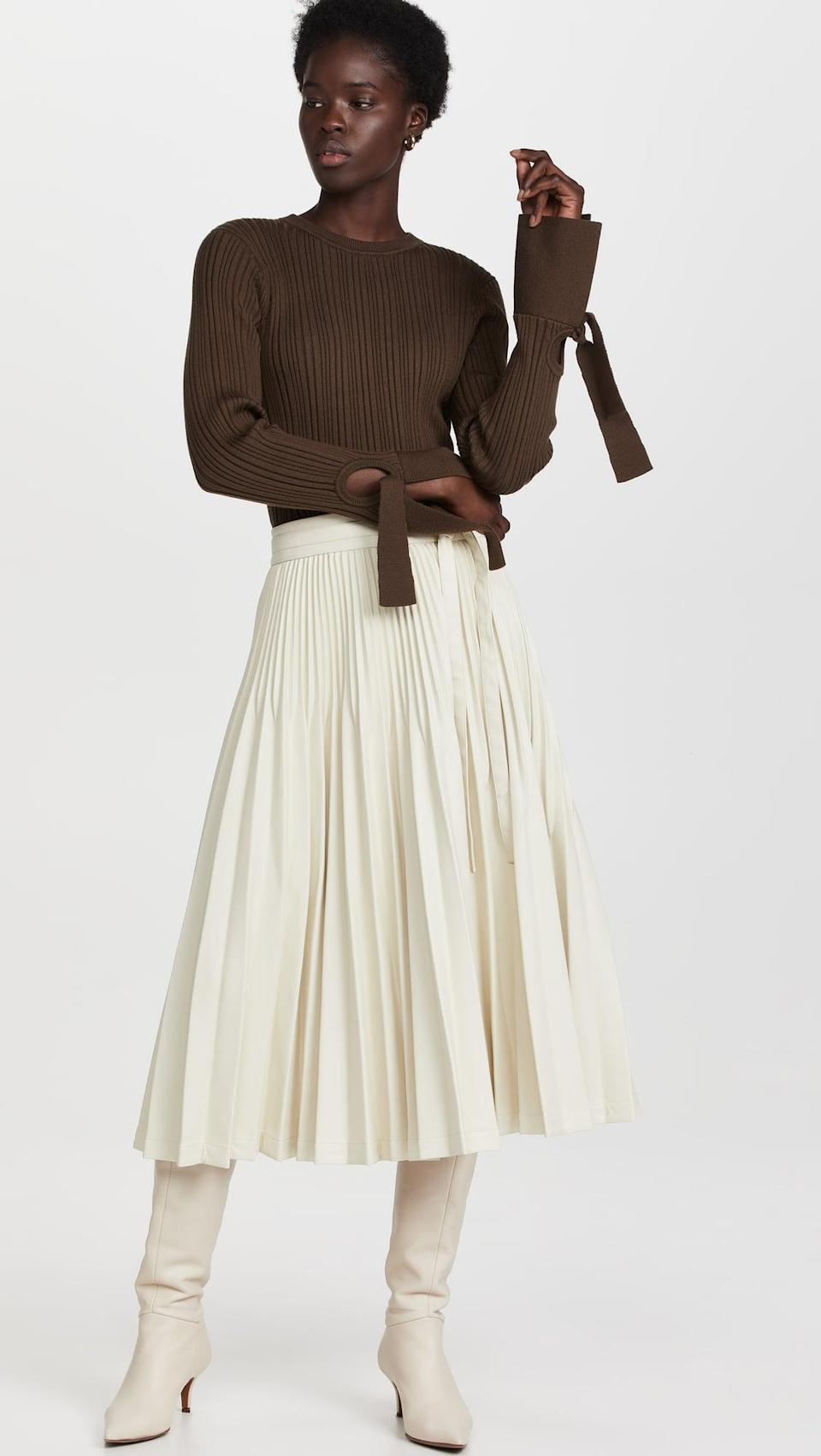 <p>This <span>3.1 Phillip Lim Vegan Leather Sunburst Pleated Skirt</span> ($550) isn't your typical leather skirt, and that's why we love it so much. The white leather is sleek and sophisticated.</p>