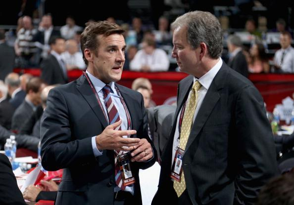 """General Manager George McPhee of the <a class=""""link rapid-noclick-resp"""" href=""""/nhl/teams/was/"""" data-ylk=""""slk:Washington Capitals"""">Washington Capitals</a> chats with general manager Ray Shero of the <a class=""""link rapid-noclick-resp"""" href=""""/nhl/teams/pit/"""" data-ylk=""""slk:Pittsburgh Penguins"""">Pittsburgh Penguins</a> during the 2013 NHL Draft at Prudential Center on June 30, 2013 in Newark, New Jersey. (Getty Images)"""