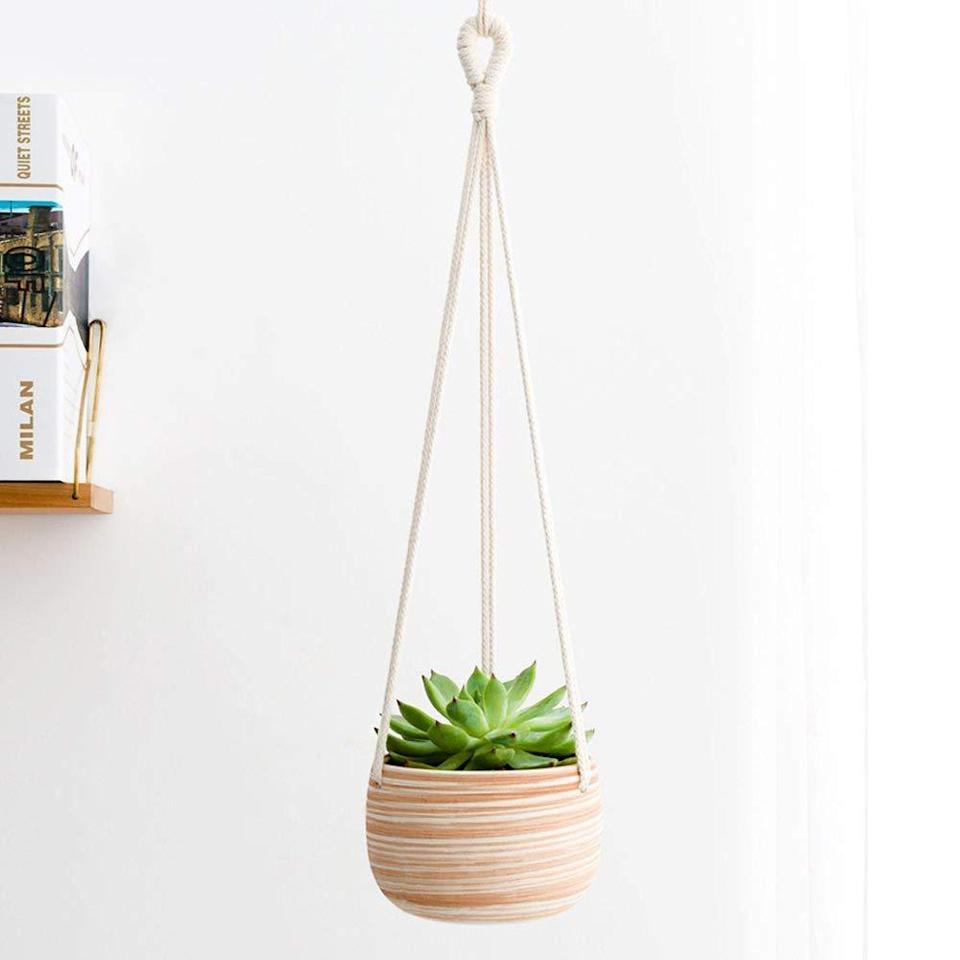 """<h2>Mkono Ceramic Hanging Planter</h2><br>This Amazon's choice ceramic and macrame hanger is a cute holder for everything from succulents and cacti to herbs and ferns. Plus, it's easy to hang.<br><br><strong>Mkono</strong> Macrame Plant Holder, $, available at <a href=""""https://www.amazon.com/Mkono-Ceramic-Hanging-Planter-Succulent/dp/B0749H4PMJ/ref=sr_1_9"""" rel=""""nofollow noopener"""" target=""""_blank"""" data-ylk=""""slk:Amazon"""" class=""""link rapid-noclick-resp"""">Amazon</a>"""