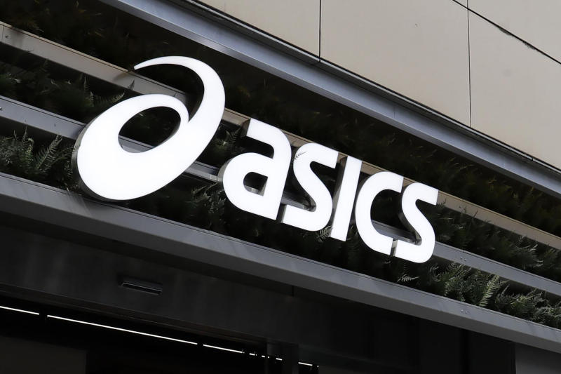 This Feb. 22, 2019, photo shows Asics logo at its shop in Tokyo. A father has filed one of Japan's first paternity harassment cases. The lawsuit against major sportswear maker Asics, which opens next week, alleges he was penalized with undesirable assignments after taking paternity leaves. The company said it will fight in court. For decades, Japanese companies have demanded selfless loyalty, long hours and foregone vacations. The attorney for the lawsuit says the case is asking the critical question of whether a worker must value company over family. (Kyodo News via AP)