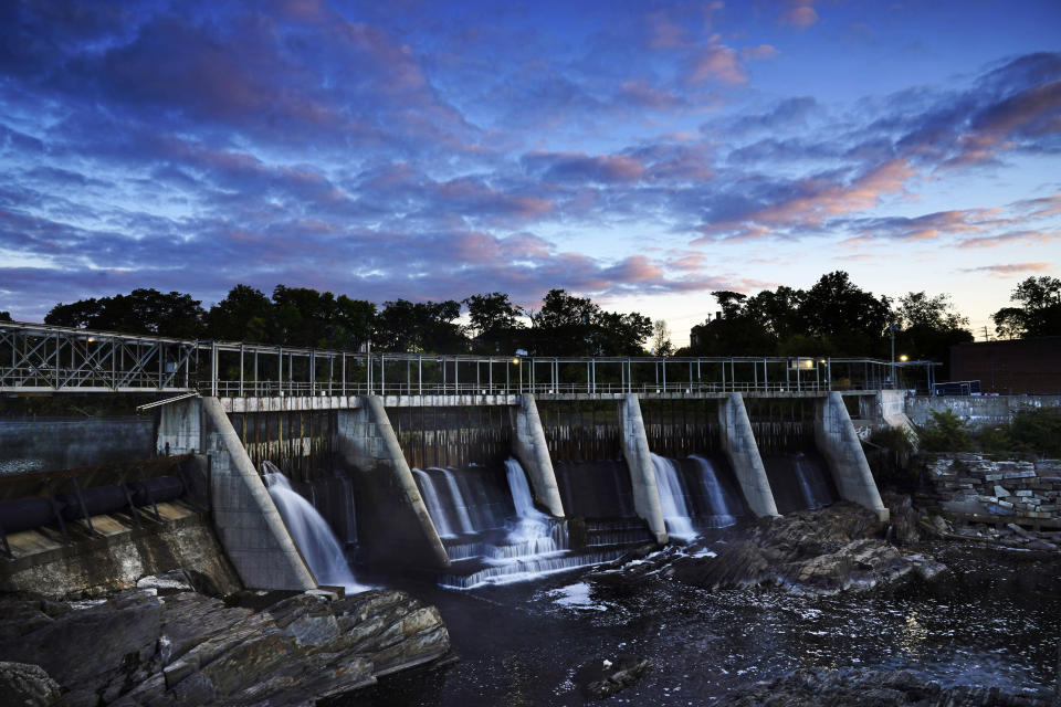 The Weston Dam holds back the Kennebec River, Tuesday, Sept. 14, 2021, in Skowhegan, Maine. Conservation groups recently filed a federal lawsuit against the Brookfield Renewable, owner of four dams along the Kennebec River, including Westin, alleging that the company is violating the Endangered Species Act. (AP Photo/Robert F. Bukaty)