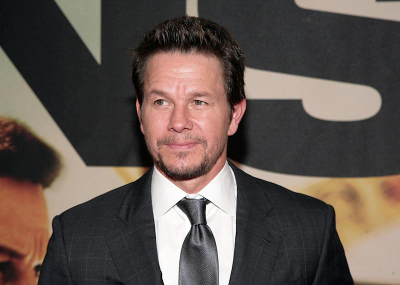 "FILE - This July 29, 2013 file photo shows actor Mark Wahlberg attends the premiere of ""Two Guns"" in New York. wahlberg will star in a new reality show, titled ""Wahlburgers,"" set in his family's Boston restaurant. For the show, actor brothers Mark and Donnie Wahlberg head back to their hometown to join forces with older brother Paul in the hamburger venture. ""Wahlburgers"" premieres January 22. (Photo by Andy Kropa/Invision/AP, File)"