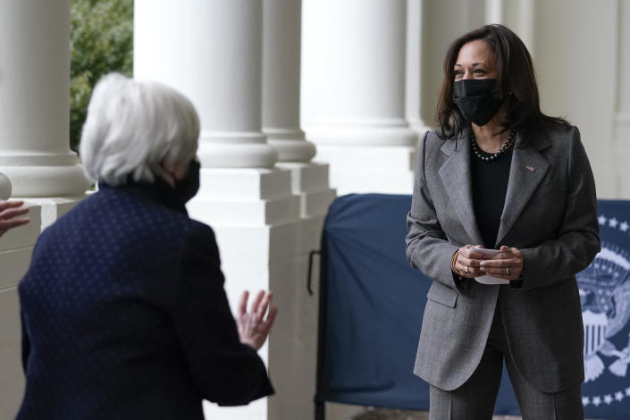 Vice President Kamala Harris departs after participating in a swearing-in ceremony with Treasury Secretary Janet Yellen, left, Tuesday, Jan. 26, 2021, at the White House in Washington. (AP Photo/Patrick Semansky)
