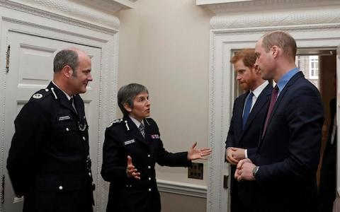 Prince William and Prince Harry, met Metropolitan Police Commissioner Cressida Dick at the reception - Credit: AFP / Adrian Dennis
