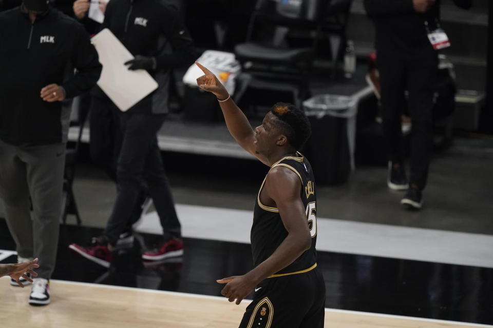Atlanta Hawks center Clint Capela celebrates after scoring against the Milwaukee Bucks during the first half of Game 4 of the NBA basketball Eastern Conference finals Tuesday, June 29, 2021, in Atlanta. (AP Photo/Brynn Anderson)