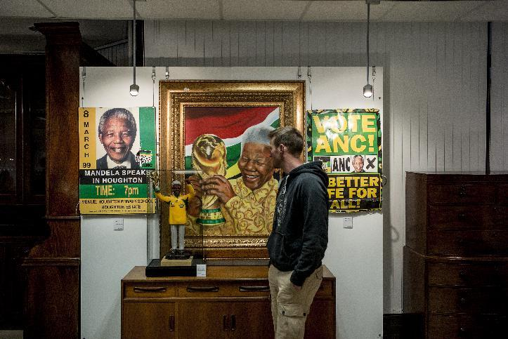 A man looks at a portrait of Nelson Mandela at the Stephan Welz and Co. auction house in Johannesburg on July 15, 2014