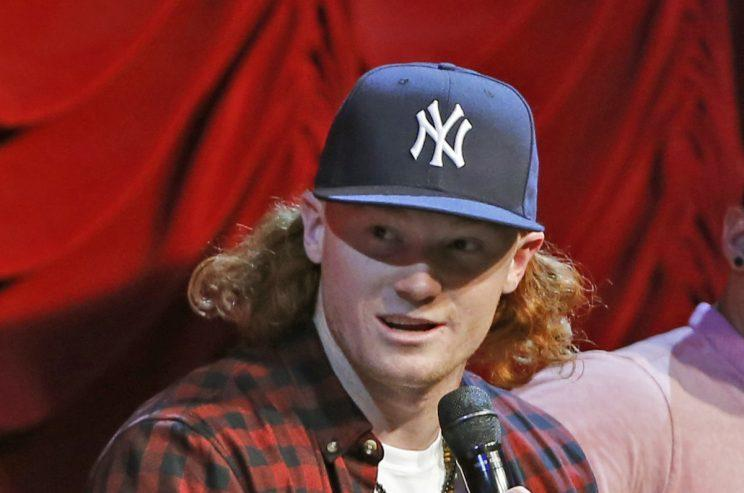 New York Yankees prospect Clint Frazier answers fan questions at the Hard Rock Cafe, Tuesday, Jan. 17, 2017, in New York. (AP Photo/Kathy Willens)