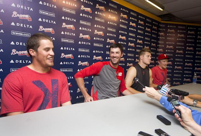 Philadelphia Phillies pitchers from left; Ken Giles, Cole Hamels, Jonathan Papelbon and Jake Diekman joke during a news conference after they combined efforts for a no-hitter against the Atlanta Braves in baseball game Monday, Sept. 1, 2014, in Atlanta. Philadelphia won 7-0. (AP Photo/John Bazemore)