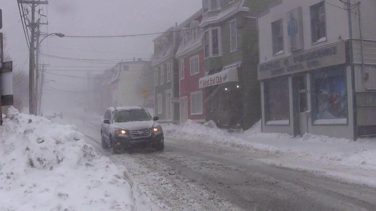 A car drives downs a snow-covered street in St. John's on Wednesday, Jan. 2, 2019. THE CANADIAN PRESS/Holly McKenzie-Sutter