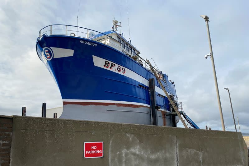 Fishing boat sits on dry platform in Macduff, Aberdeenshire