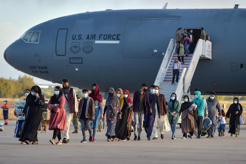 Refugees disembark from a US air force aircraft after an evacuation flight from Kabul at the Rota naval base in Rota, southern Spain, on August 31, 2021. (Cristina Quicler/AFP via Getty Images)